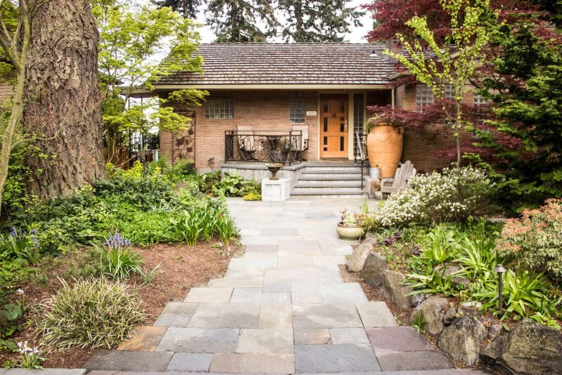 blue stone walkway with native plants, landscape architecture and design