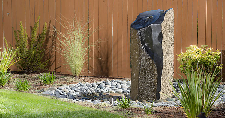 Basalt columnar water feature co-design installation by Urban Oasis LLC