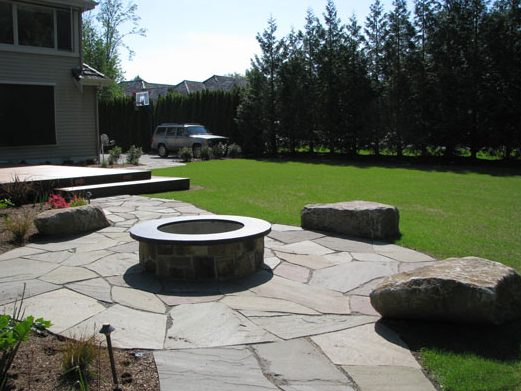 gas burning fire pit for outdoor room and seating area landscaping and hardscaping design and construction by urban oasis llc near seattle bellevue wa