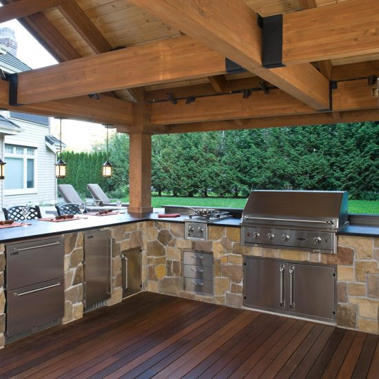 outdoor living space with covered structure and stone kitchen and outdoor grill
