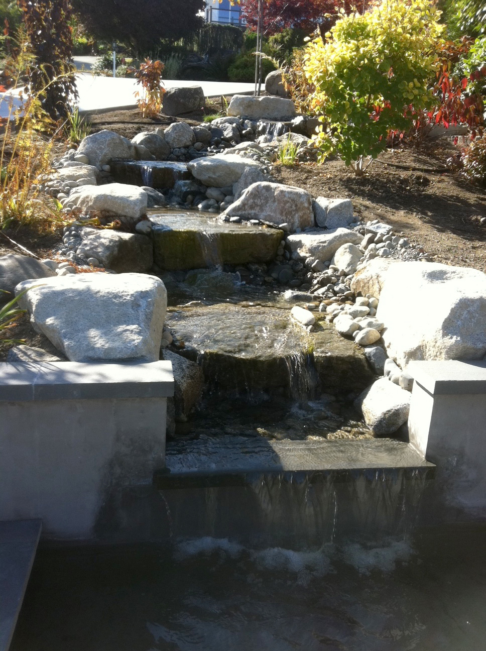 Water features urban oasis design construction llc for Waterfall seat design