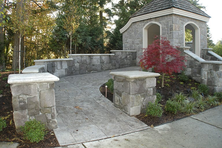 Highlands at Newcastle, gateway entry. Stone veneer walls and wheel chair accessible ramp