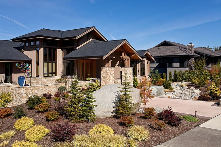 Landscape architecture, front yard with natural stone path and native plants.