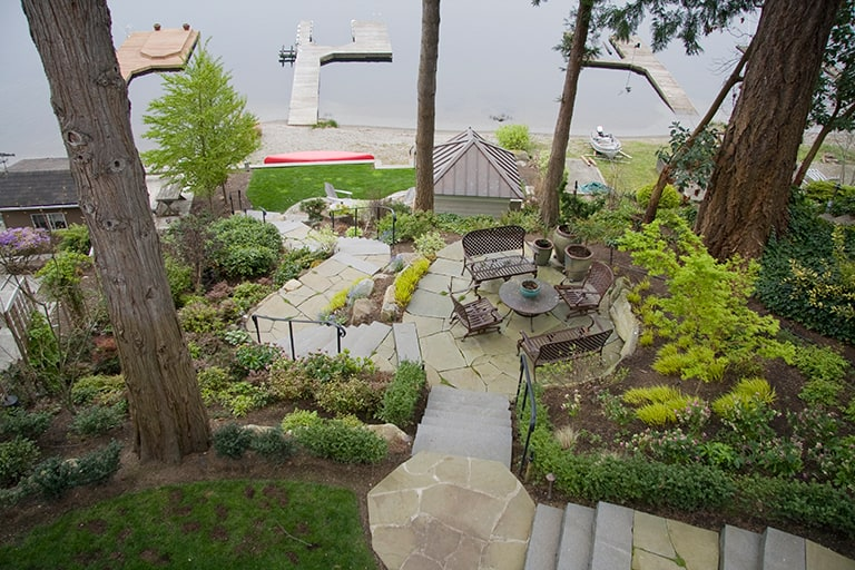 Landscape architecture with stone steps, and pathway, as well as native plants