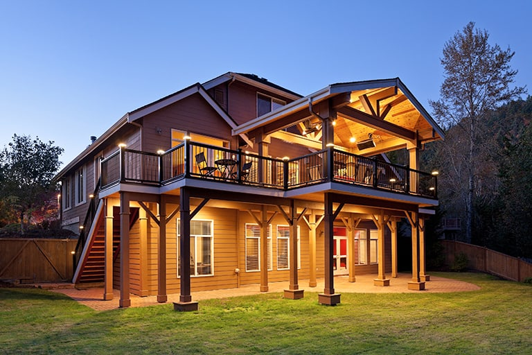 outdoor living with covered patio structure and light installations