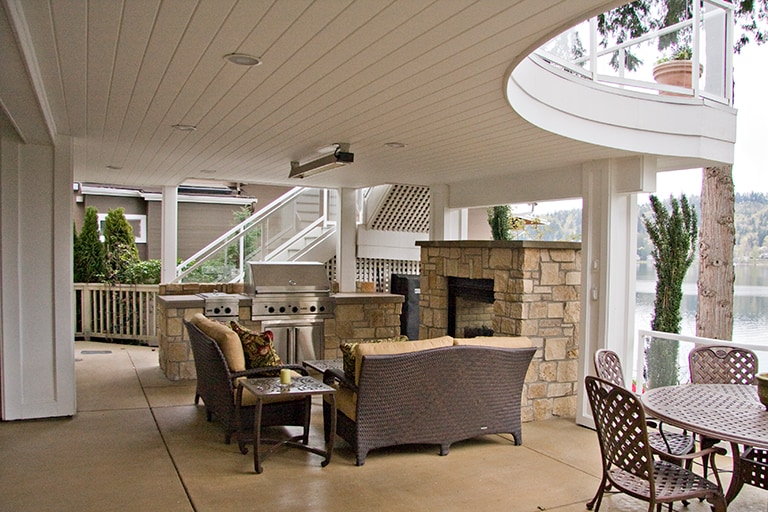 outdoor living, covered patio with stone fireplace and dining area