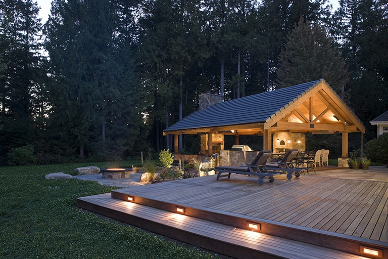 landscape architecture, large upscale covered patio with stone walls, fireplace. and light installations